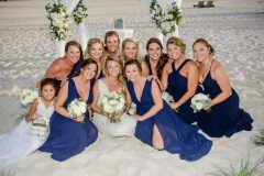Happy-Bride-and-Bridesmaids-sitting-in-the-Sand-Gulf-State-Park_resize