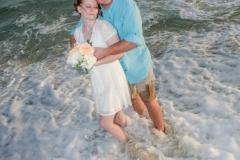 Orange-Beach-Bride-and-Groom-in-Water_resize